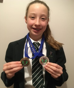 Emilia Competes at Swimming Championships